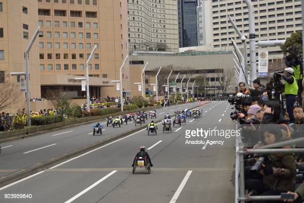 Men wheelchairracers leave the starting line of the12th Tokyo Marathon in front of the Tokyo Metropolitan Government in Tokyo Japan on Sunday...