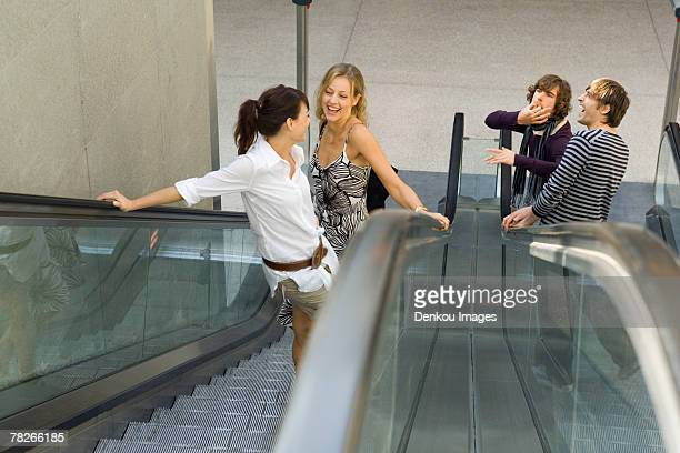 Men whistling at women on the escalator.