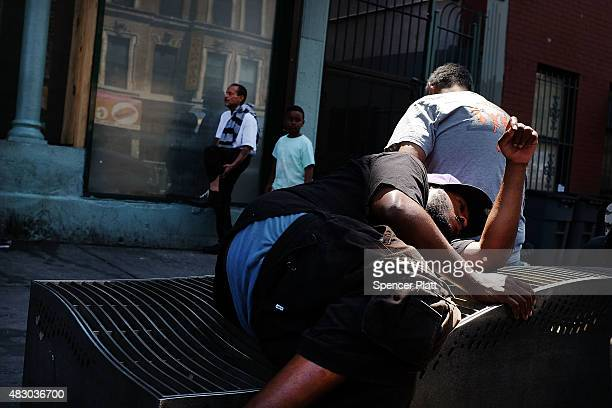 """Men who are high on K2 or """"Spice"""", a synthetic marijuana drug, sleep along a street in East Harlem on August 5, 2015 in New York City. New York,..."""