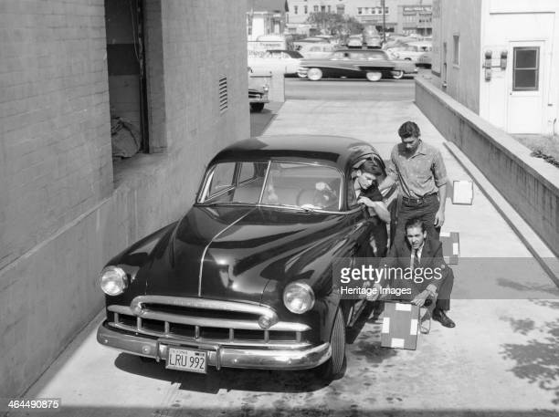 Men with a 1949 customised Chevrolet with California license plates