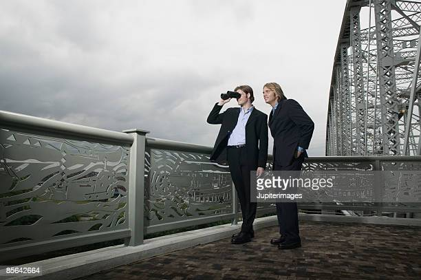 Men with binoculars outdoors