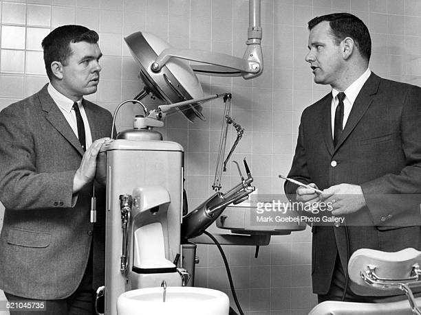 Men with dental equipment, late 1960s.