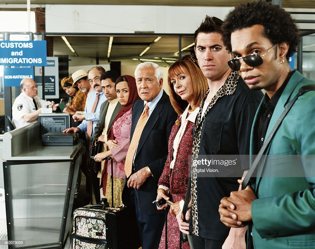 Men With Drugs at Airport Security : Stock Photo