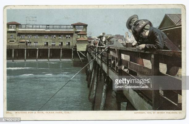 Men with fishing rods looking down from pier into water Ocean Park California USA 1914 From the New York Public Library