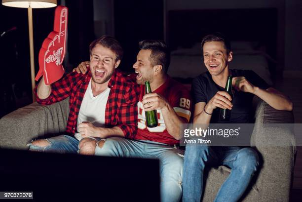 men with foam hand and beer at football party. debica, poland - foam finger stock photos and pictures