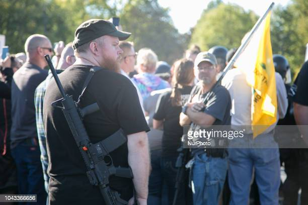 Men with guns gather during an open carry rally at Kent State University in Kent Ohio on September 29 2018