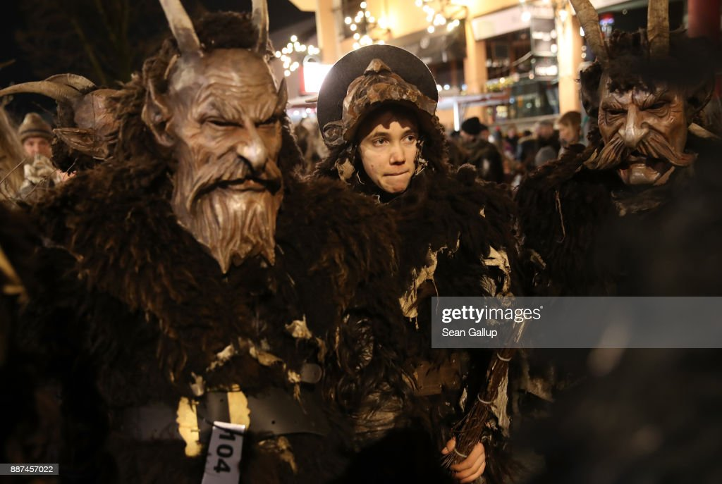 Men with horned, wooden masks and dressed as the Krampus creature prepare to participate in the annual Krampus parade on Saint Nicholas Day on December 6, 2017 in Sankt Johann im Pongau, Austria. Several hundred Krampus creatures from the region took part in this year's Sankt Johann parade. Krampus traditionally accompanies Saint Nicholas and angels in a house to house procession to reward children who have been good and warn those who have not, though in recent decades Krampus parades have become an intrinsic part of local folklore and take place throughout the end of November and into the first half of December in the alpine regions of Germany, Austria and Italy. Krampus usually wears large cowbells on his back that he rings by shaking his hips to ward off the evil spirits of winter. He also carries a switch made of branches or animal hair that he uses to whip bystanders.