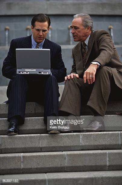 Men with Laptop on Stairs