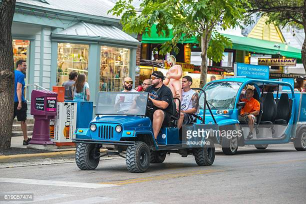men with sex doll driving on duval street, key west - duval street stock pictures, royalty-free photos & images