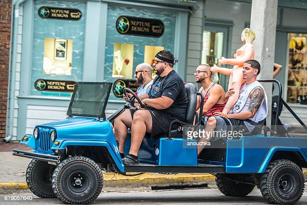 men with sex doll driving on duval street, key west - blow up doll stock pictures, royalty-free photos & images