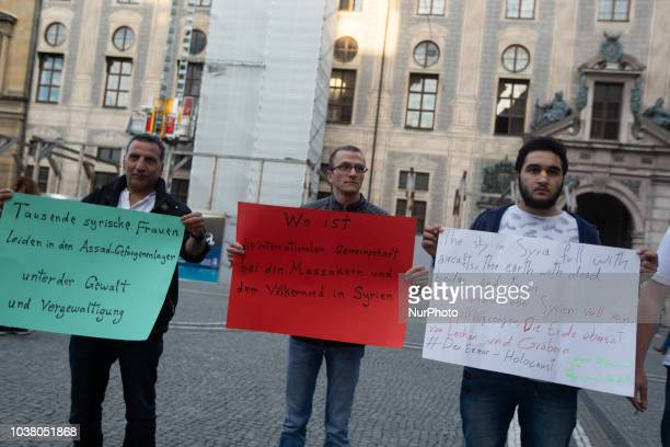 A woman with a sign saying 'Seven and a half years of revolution / The difficult way to liberty / Syria bleeds' A dozen of oppositional Syrians...