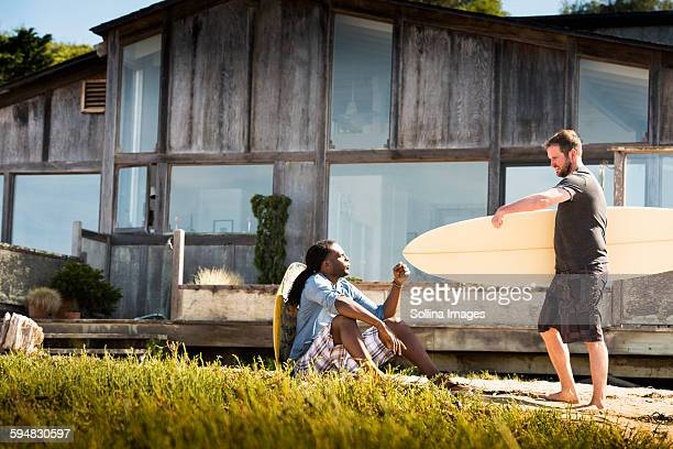 Men with surfboards outdoors