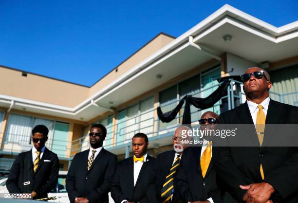 Men with the Alpha Phi Alpha fraternity stand outside the National Civil Rights Museum on April 4 2017 in Memphis Tennessee The balcony draped in...