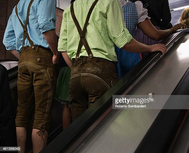 CONTENT] Men with traditional clothes on escalators