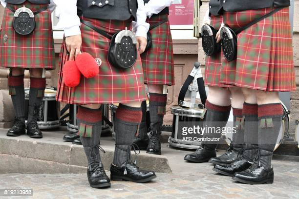 Men with traditional Scottish kilts get ready for the visit of Britain's Prince William Duke of Cambridge his wife Kate the Duchess of Cambridge with...