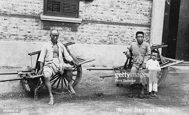 Men with wheelbarrows, Vietnam, 20th century.