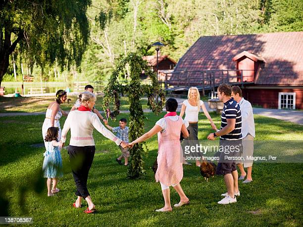 men, women and children dancing in circles - swedish culture stock pictures, royalty-free photos & images