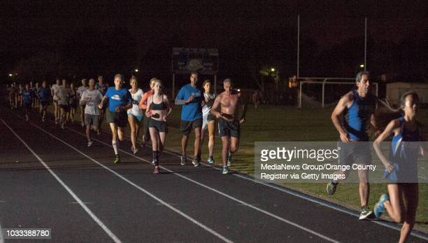 Men women and teens of the CalCoast Track Club ranging in age from 13 to 83yearsold train at the Corona del Mar High School track ///ADDITIONAL...