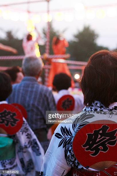 Men & women wearing yukatas, maturi in Japan