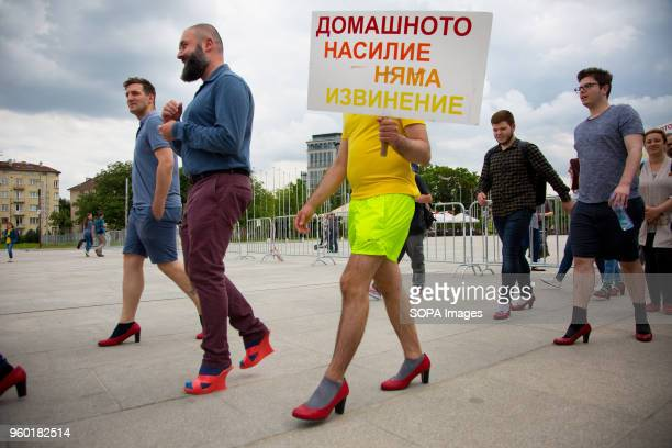 Men wore highheeled shoes and walked around the park holding signs like 'No Excuse for Domestic Violence' in front of the National Palace of Culture...