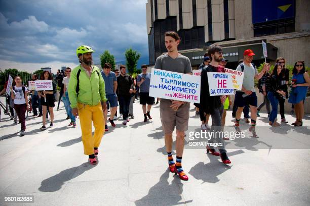 Men wore highheeled shoes and walked around the park in front of the National Palace of Culture in Sofia to show solidarity with women and the...