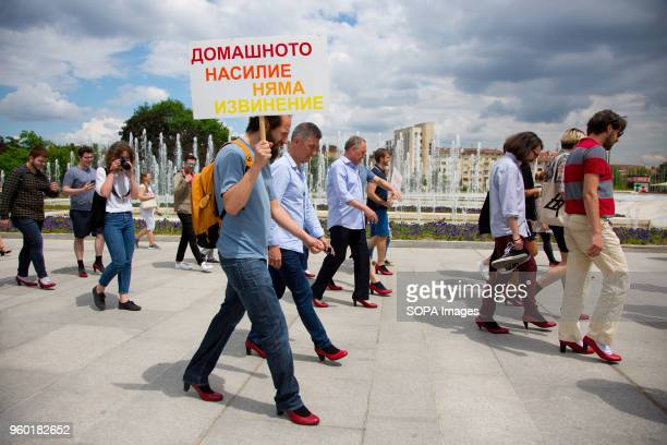 Men wore highheeled shoes and walked together in the center of Sofia in order to show solidarity with women and the struggles they face during the...