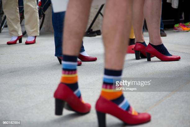 Men wore highheeled shoes in order to show solidarity with women and the struggles they face during the 'Walk a Mile in Her Shoes campaign to draw...