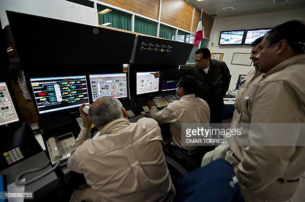 Men work at a control station at Mexican stateowned petroleum company PEMEX refinery in Tula Hidalgo state Mexico on March 8 2011 AFP PHOTO/OMAR...