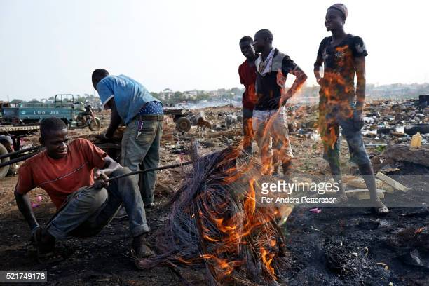 Men work at Agbogbloshie a Huge recycling area on April 19 2015 in central Accra Ghana Everything is recycled and bartered here Most popular are...