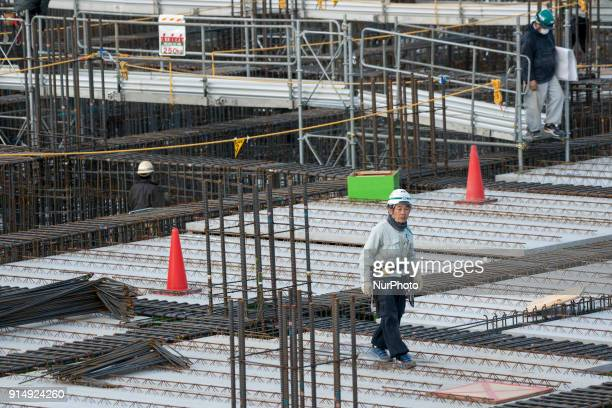Men work at the construction site for the Tokyo 2020 venue quotAriake Arenaquot in Tokyo on February 6 2018 The new facility will host volleyball...