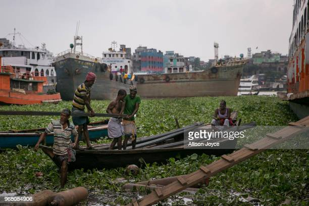 Men work in a dockyard on the Buriganga river on June 4 2018 in Dhaka Bangladesh Bangladesh has been reportedly ranked 10th out of the top 20 plastic...