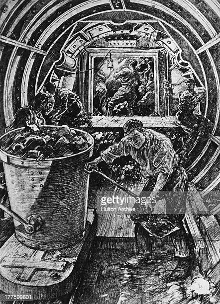 Men work in cramped conditions under the River Thames on the Greathead shield as part of the Waterloo and City underground line London 16th November...