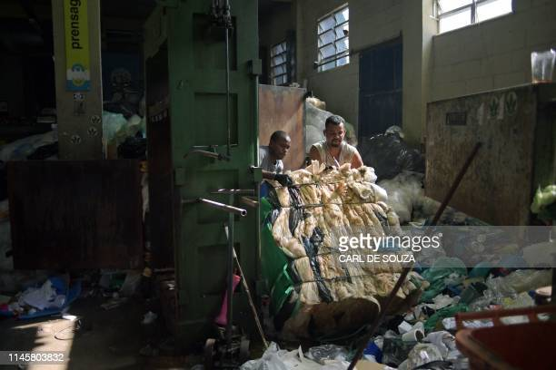 Men work in the recycling of plastic bags at CoopFuturo a sorting collective which receives rubbish from the local government collection service and...