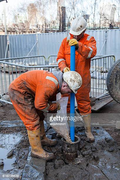 Men work on a borehole