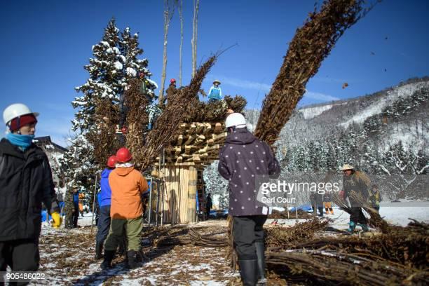 Men work on constructing the shrine during preparations for the Nozawaonsen Dosojin Fire Festival on January 15 2018 in Nozawaonsen Japan The...