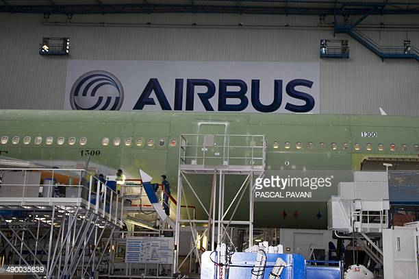 Men work on the Airbus A330 assembly line in Colomiers southwestern France on January 19 2012 AFP PHOTO/PASCAL PAVANI