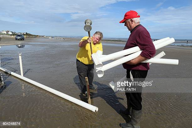 Men work to erected a temporary race course at Laytown beach in County Meath on the east coast of Ireland on September 13 2016 for the Laytown Strand...