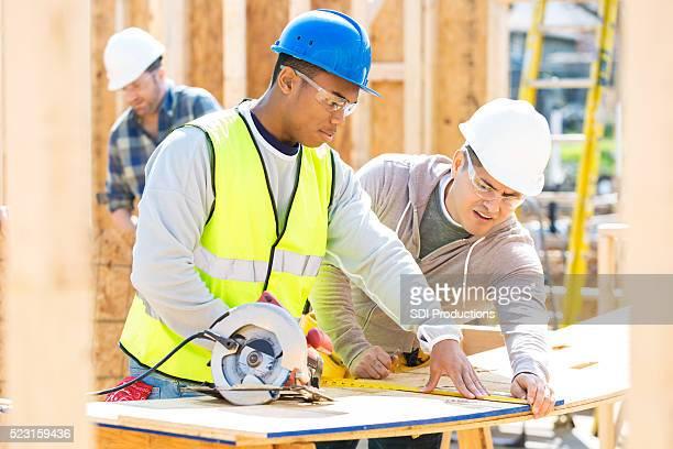 Men work together at construction site