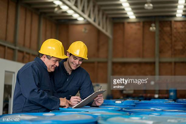 Men working at a chemical plant