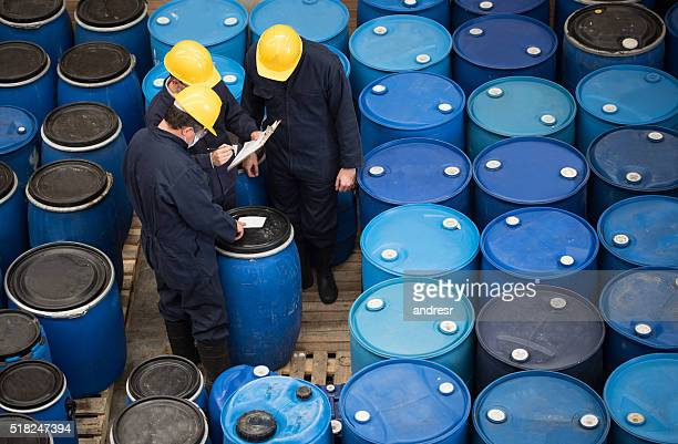 men working at a chemical warehouse - chemistry stock pictures, royalty-free photos & images