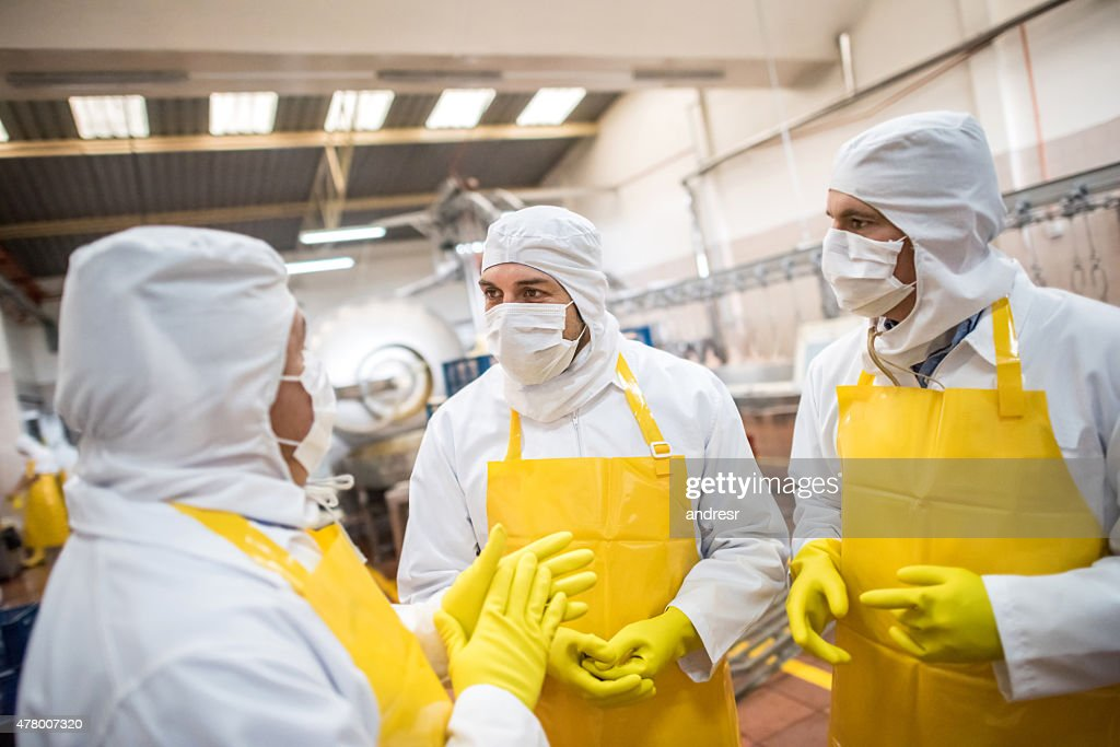 Men working at a food factory : Stock Photo