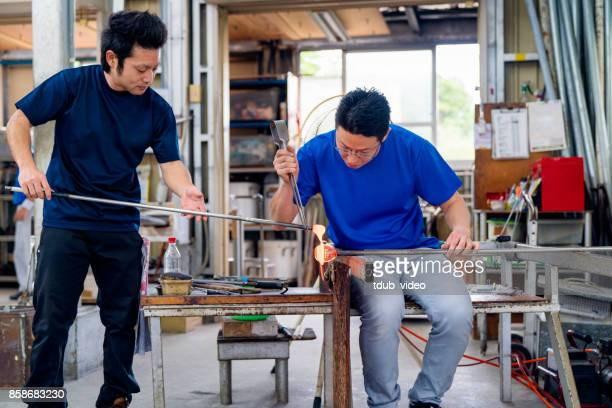 Men working at a glass factory