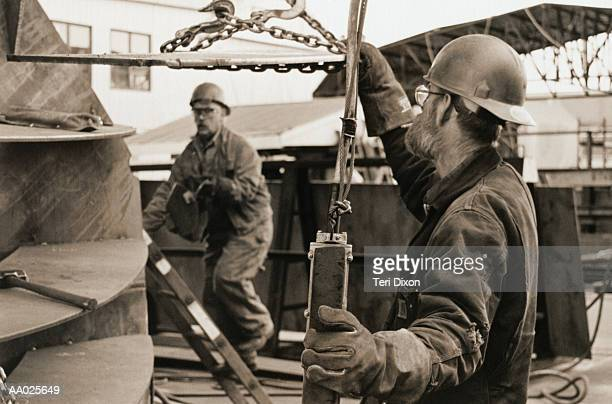 Men Working at a Shipbuilding Site