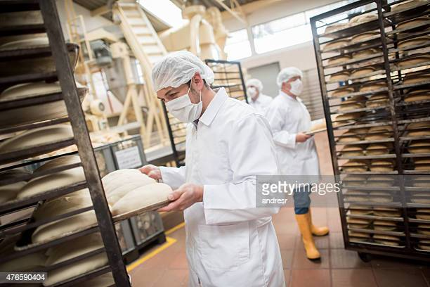 Men working at an industrial bakery