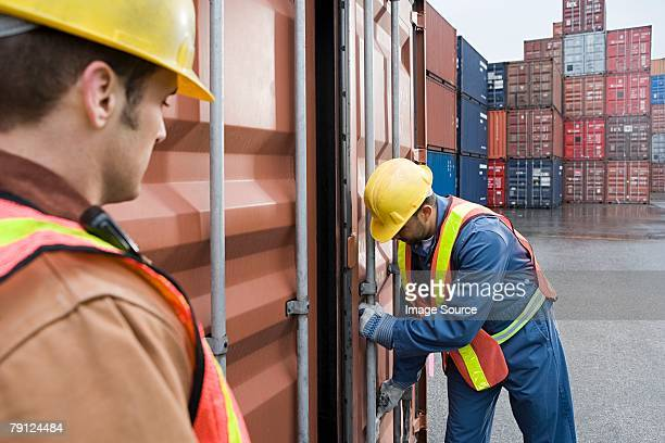 Men working at container terminal