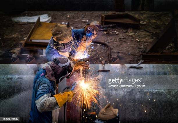 men working at factory - pipeline stock pictures, royalty-free photos & images