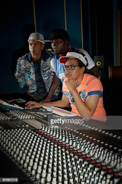 3 men working at mixing deck