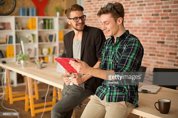Men working at modern office.