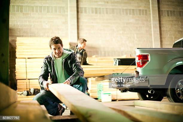 men working in carpenters workshop - offloading stock pictures, royalty-free photos & images