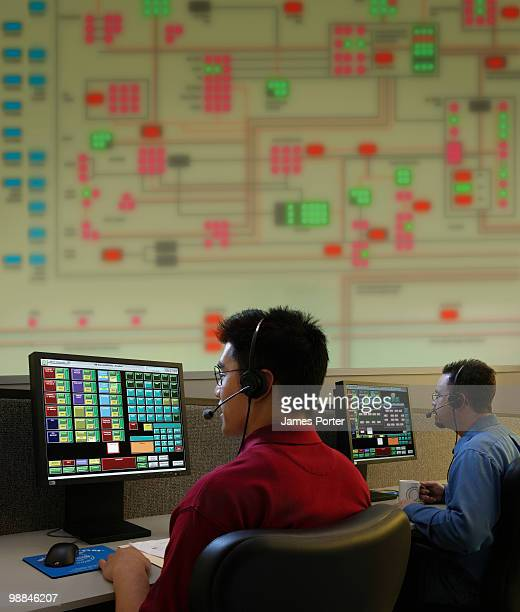 Men working in control room of water treatment plant